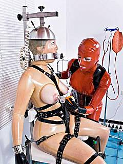 Forced lactating: latex mistress is using BDSM chair and vacuum pumps to get some milk from slave's tits