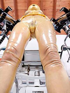 Cruel mistress performes a sries of kinky actions with a helplessly restrained latex slave