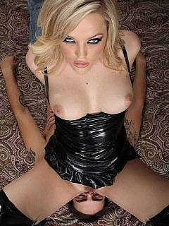Horny blonde in black latex is spreading her legs so her pussy can be licked
