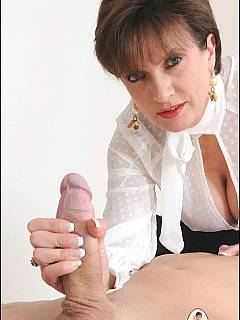 CFNM handjob: mature lady is handling slave's cock as a pro whore