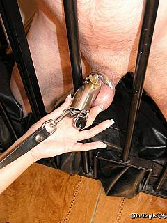 Woman keeps her husband nude, behind the bars and with his cock locked in a steel chastity device