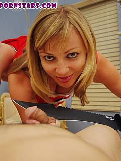 POV scene where blonde cheerleader is going to cut your sausage off with the knife