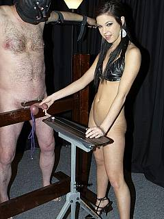Mistress Lexi is extracting cum from slave's cock by milking it violently