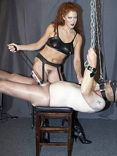 Redhead bitch is trying desperately to make slave's cock hard by using the vacuum pump