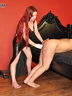 Smoking mistress is educating the slave by shoving her hand into his ass and facesitting him