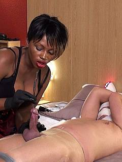 Male in pantyhose is bound with duct tape and wires are being inserted in his cock by black mistress