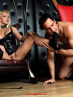 Dominatrix is milking a guy while he is restrained naked on a BDSM cross