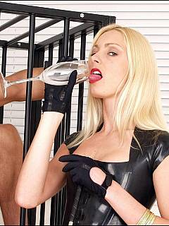 Leggy bitches from UK are kicking caged guy in his manhood and milking him after