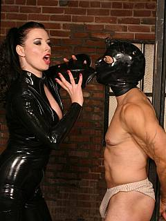 Dominatrix enters the prison cell to torment the inmate