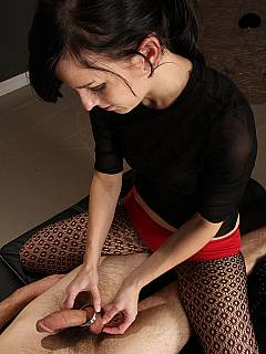 Cock is teased with tight clothespins, a couple of vibrators and agile female hands
