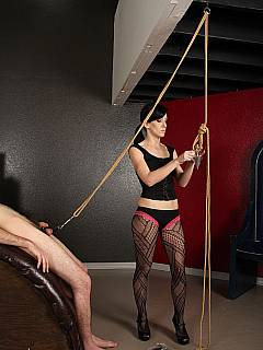Pulling harnessed balls with rope and punishing them with tiny whip