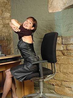 Naughty office slut is wearing leather underneath her clothes
