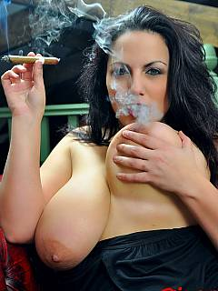 Plumper domme is smoking sexy and exposing a pair of massive boobs