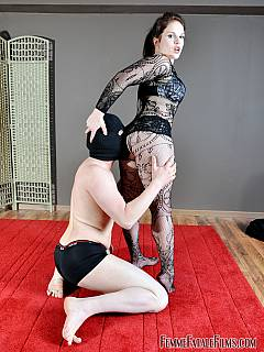 Slave tries wrestling his dominatrix but ends up licking her ass on his knees