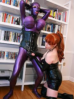 Mature bitch dressed up her sub in full-body latex costume, teasing his cock with a handjob but not allowing to cum