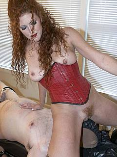 Redhead babe understands the power she has over her slave: free to do anything to him including painful femdom tortures