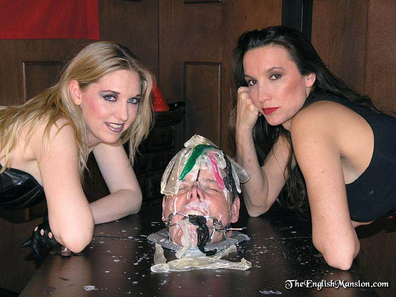 Picture #15 of Male slave is put in a box by two girls, his mouth is open and bitches are feeding him with cum from used condoms