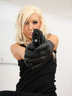 You have been captured by a sexy spy: she is going to turn you into a sissy threatening with a gun