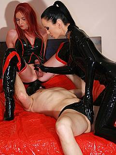 Dominatrix in black latex is having cross-dressed sissy and femdom slave to fuck with