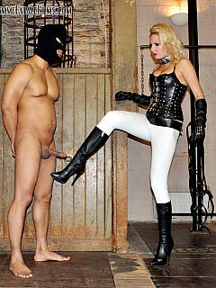 High-heeled mistress is hurting her slave by putting him in different poses and then kicking his balls