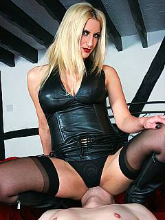 Dominatrix is resting her high-heeled legs on slave's chest and then topping his face as if he is a human chair