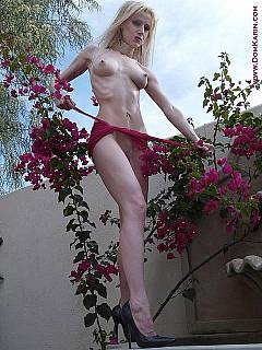 Dominatrix is relaxing naked at the backyard after spending long day dominating men