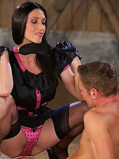 Beautiful mistress is wrapping her slave in plastic getting ready to ride his cock