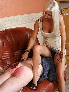 Big and strong male is getting silent and submissive when dominant blond takes out her wooden paddle