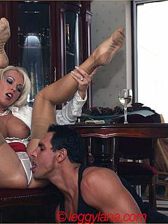 Mistress is going to blow smoke while kneeling man is licking her feet and pussy