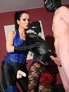 Sissification in progress: dominatrix is dressing up male slut in lingerie and forcing him to blow another femdom sub