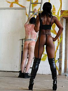 White sissy is taken care of by a strong black woman: bound with duct tape and whipped