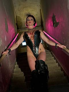 Dominatrix goes down to the torture chamber to fuck fem dom slave and humiliate caged rival