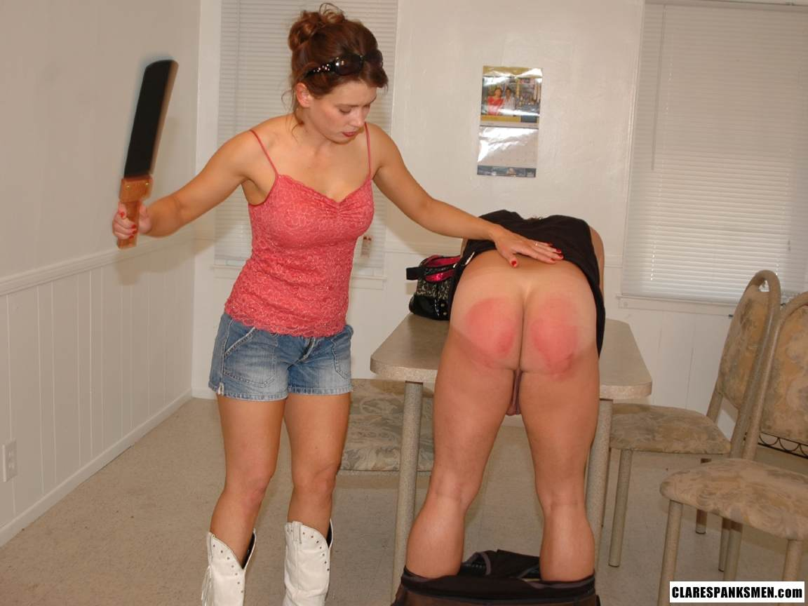 Picture #3 of Big guy submits to his wife: bends over the table and exposes his ass for her to paddle