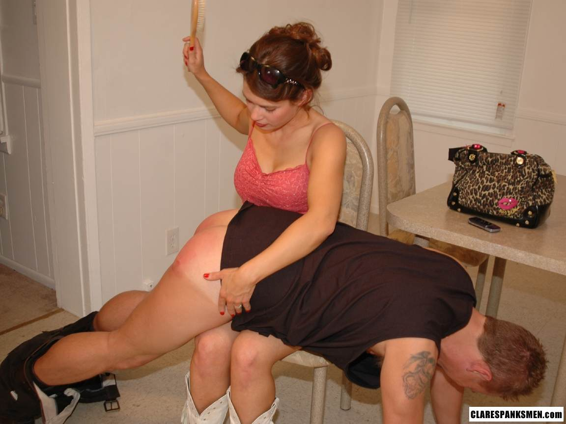 Picture #13 of Big guy submits to his wife: bends over the table and exposes his ass for her to paddle