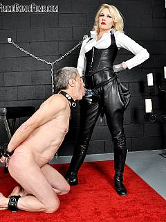 The oldest femdom slave ever: 65-year old dude in nude, handcuffed and sucking girl's strapon on his knees