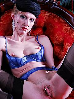Femdom mistress is wearing blue lingerie underneath her everyday clothes