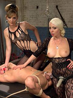 Helpless prisoner becomes a sex toy for a couple of extremely sexy ladies visiting him
