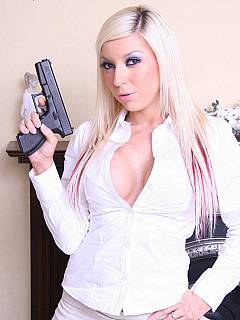 Sexy girl with the gun is not going to let you fool around