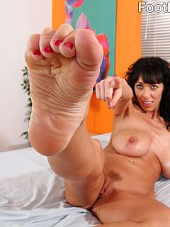 Filthy mom enjoys the feeling of big young cock in between her feet