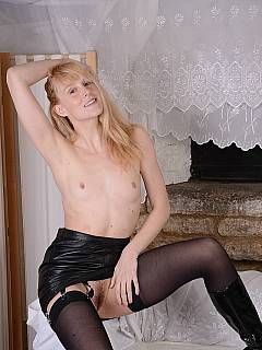 Mistress with small tits is going to tease you with an extremely short skirt and a pair of high heel boots