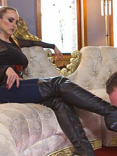 Mistress is jeans is using high heel shoe to milk chained femdom slave: her cums all over her sexy footwear