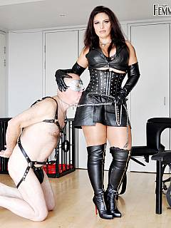 Harnessed dude belongs to the leather-dressed beauty: doing things on command and loving being femdom slave