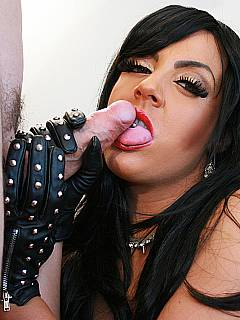 Femdom mistress is sexy leather is smoking a cigarette before taking a load in her mouth