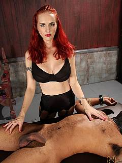 Cruel redhead is using steel wire to penetrate bandaged slave's penis