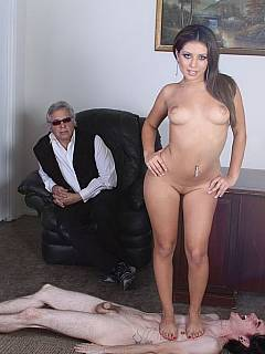 Old man and his son are both worshipping beautiful young latina: her pussy and soles are being licked