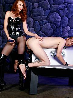 Femdom slave feels good having his balls clamped with wooden vice and his ass destroyed by a hot redhead domme
