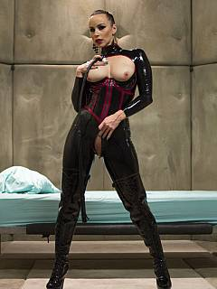 Catwoman is sexually abusing submissive male using a couple of kinky toys to make his torment more enjoyable