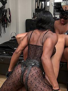 Poor male is surrounded by three beautiful tall black women: going to be dominated with brutal strap-on penetrations