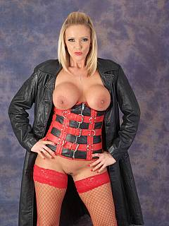 Goddess is unbuttoning black coat exposing tight leather corset she is wearing underneath