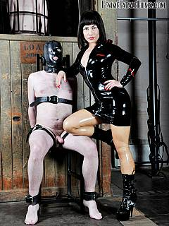 Chair-tied femdom slave opens his mouth for sexy domme in latex to spit into